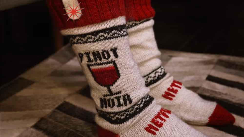 These Netflix socks are designed to pause your favorite show when you fall asleep in front of the TV