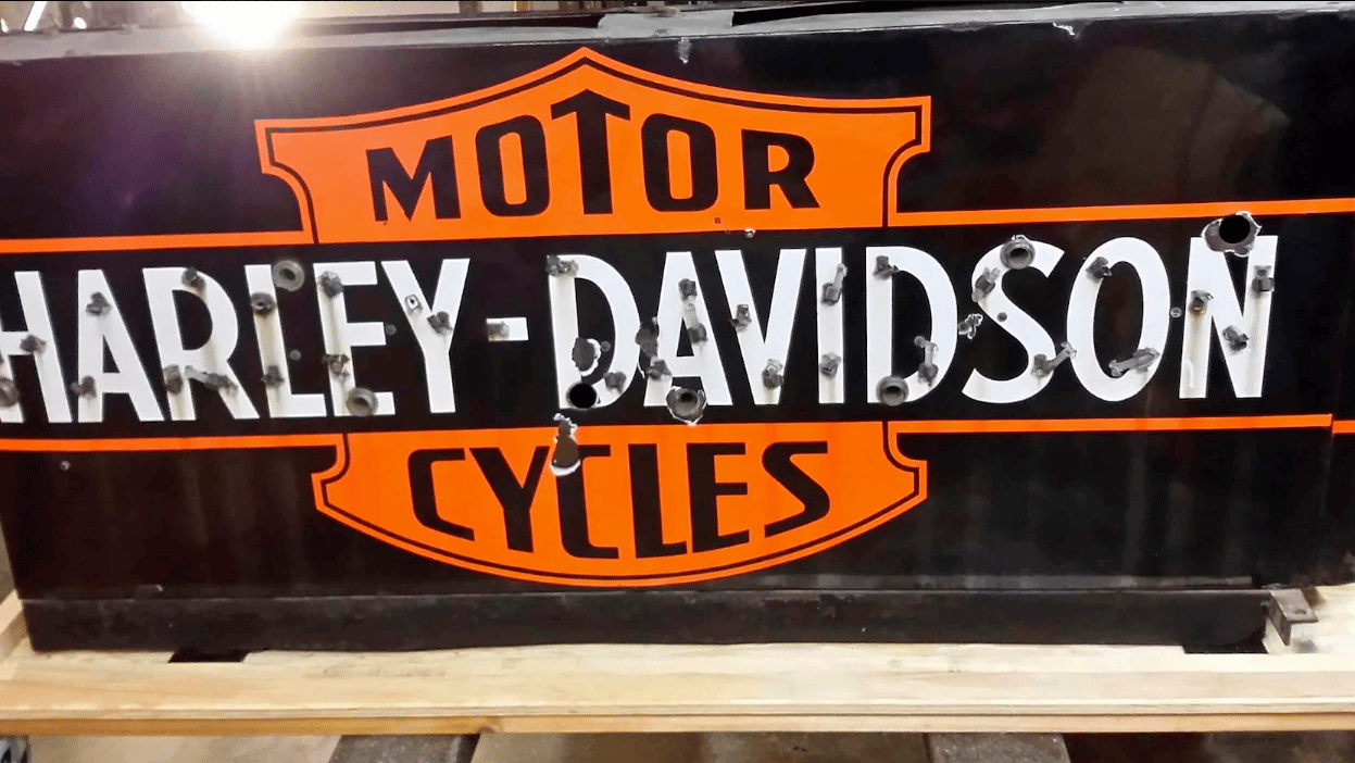 Thisis the actual neon sign that hung over the Harley-Davidson visitor/employee entrance at the Milwaukee factory for many decades, complete with photographic evidence showing that the water stains on the sign match those on the original in situ. A piece of motorcycle history without doubt, but it's ironic that it sold for just $3,500 less than the Honda RC30, which in turn, is the fifth most valuable Japanese motorcycle ever sold.