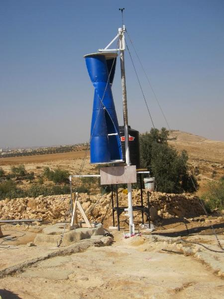 The turbine structure is made from recycled plastic barrels and connected to the cistern