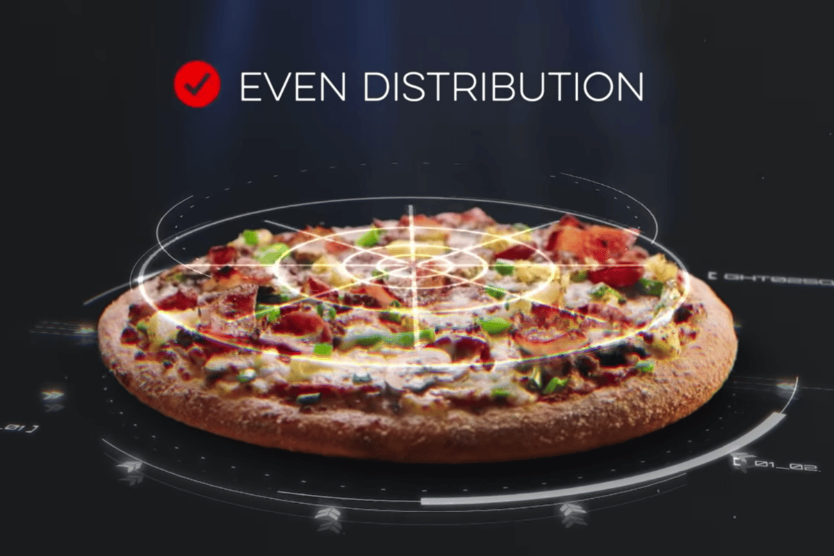 The system leverages artificial intelligence as a form of quality control before pizzas are sent on their way