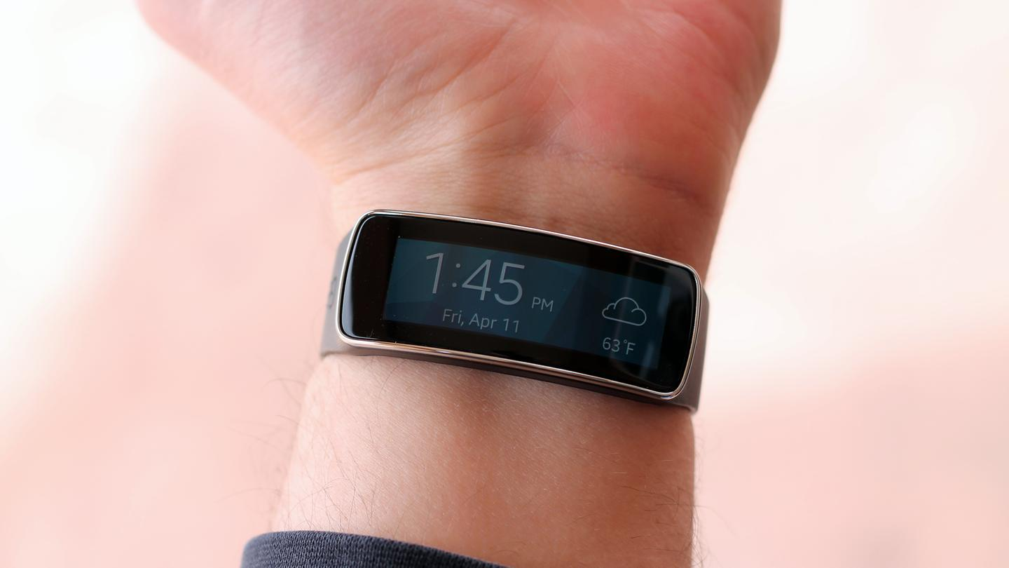 The Gear Fit's home screen shows you the time and weather
