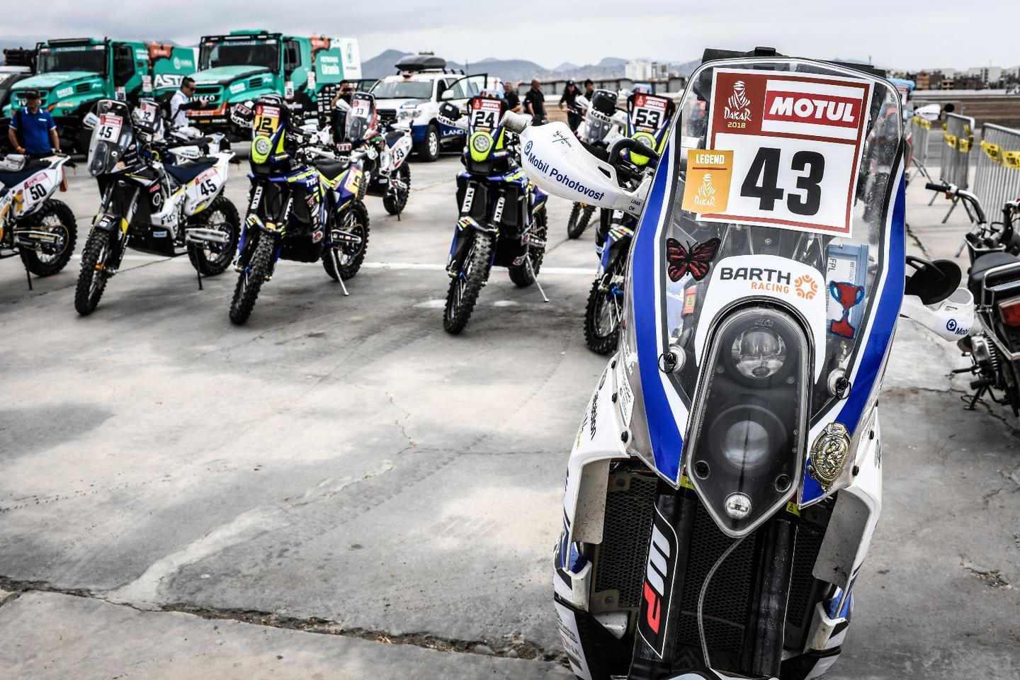 Before the storm: motorcycles lined up for scrutineering in Lima, Peru