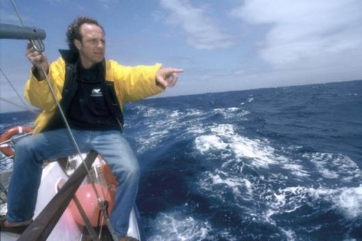 André at sea pointing to a group of sperm whales Photo: Rolex / Eric Vandeville (Copyright)