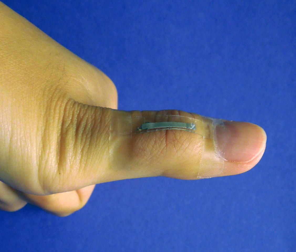 A silver nanowire-based sensor mounted onto a thumb joint to monitor the skin strain associated with thumb flexing (Photo: Shanshan Yao)