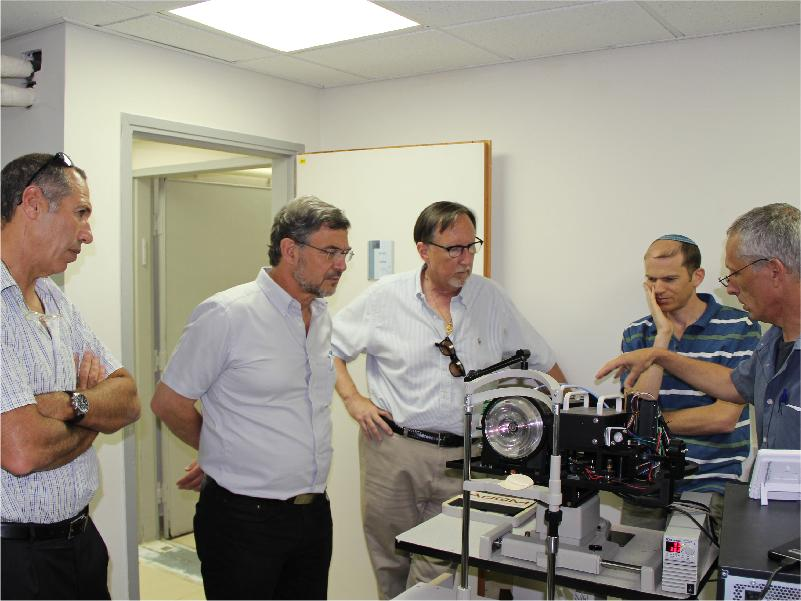 Members of the AdOM team with their device