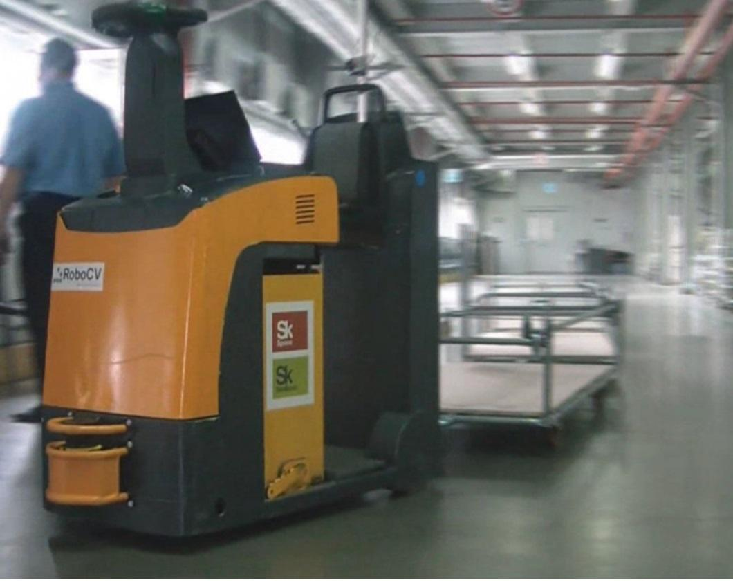 According to RoboCV, the X-MOTION system can be fitted to tow tractors, pallet lifters, forklifts and high-rack stackers