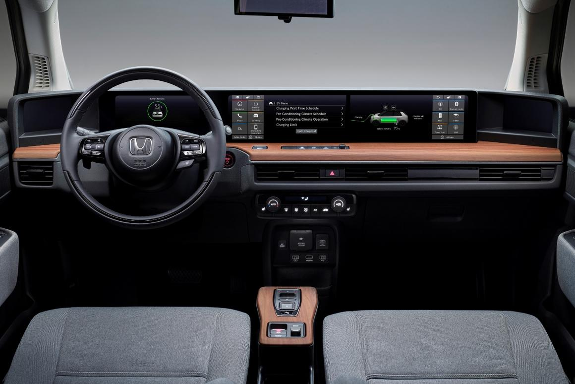 Five neatly integrated high-resolution color screens occupy the entire width of the Honda e's dash