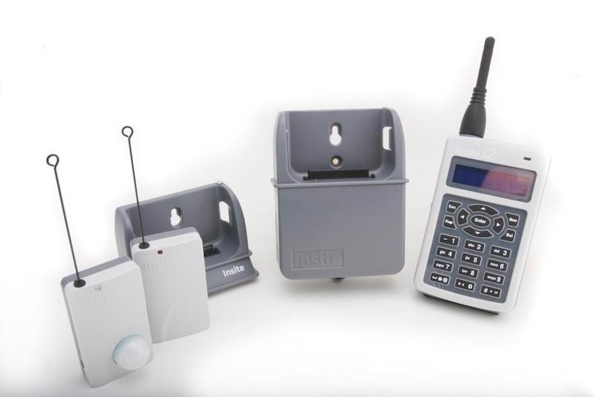 The Insite PGAMS i2 base unit, docking station, and wireless transmitters
