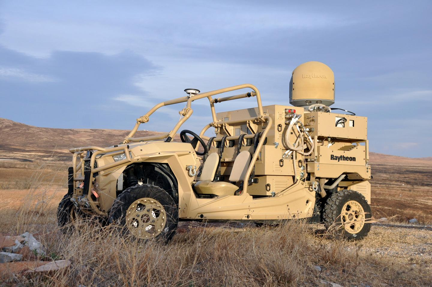 The vehicle-mounted laser combines a solid state laser with an advanced variant of the company's Multi-Spectral Targeting System,  installed on a small, all-terrain Polaris militarized vehicle