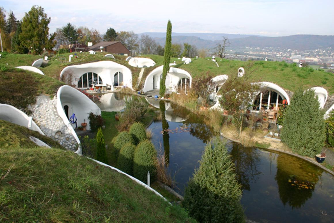 The Earth House Estate Lättenstrasse in Switzerland consists of several Hobbit Hole-style dwellings located around a wet courtyard