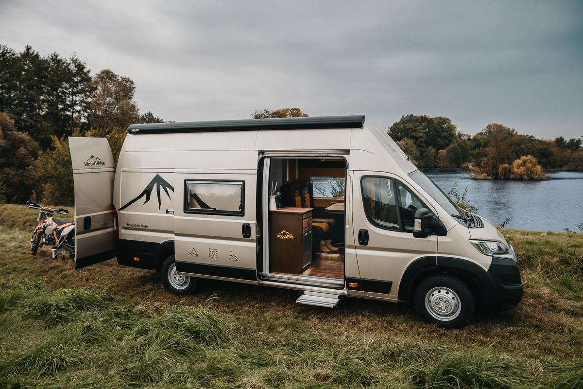 Built into a Citroën Jumper, the WoodVans Moto package combines a tiny lodge-like interior and motorcycle garage into a capable adventure camper van