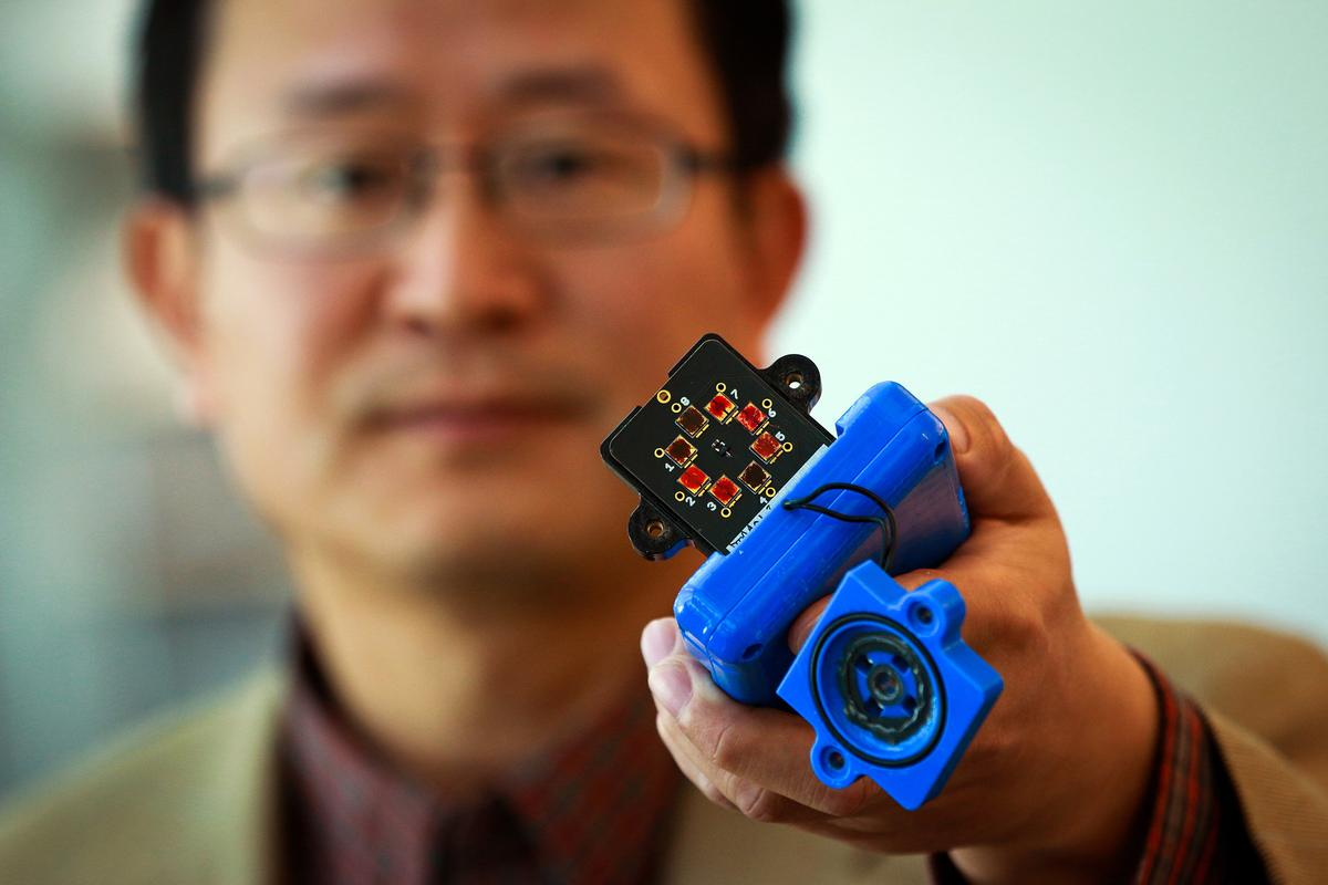 Ling Zang with his prototype explosives sensor (Photo: Dan Hixon, University of Utah College of Engineering)