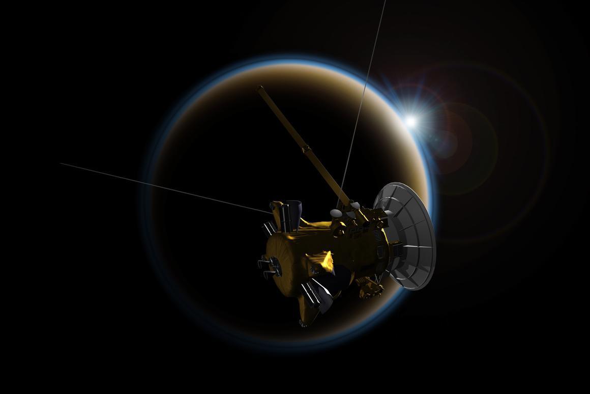 Artist's Impression of Cassini passing near Titan (Image: NASA/JPL-Caltech)