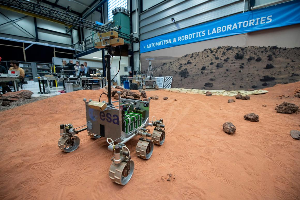 ExoMars Testing Rover (ExoTeR), seen maneuvering itself carefully through the red rocks and sand of thePlanetary Utilisation Testbed