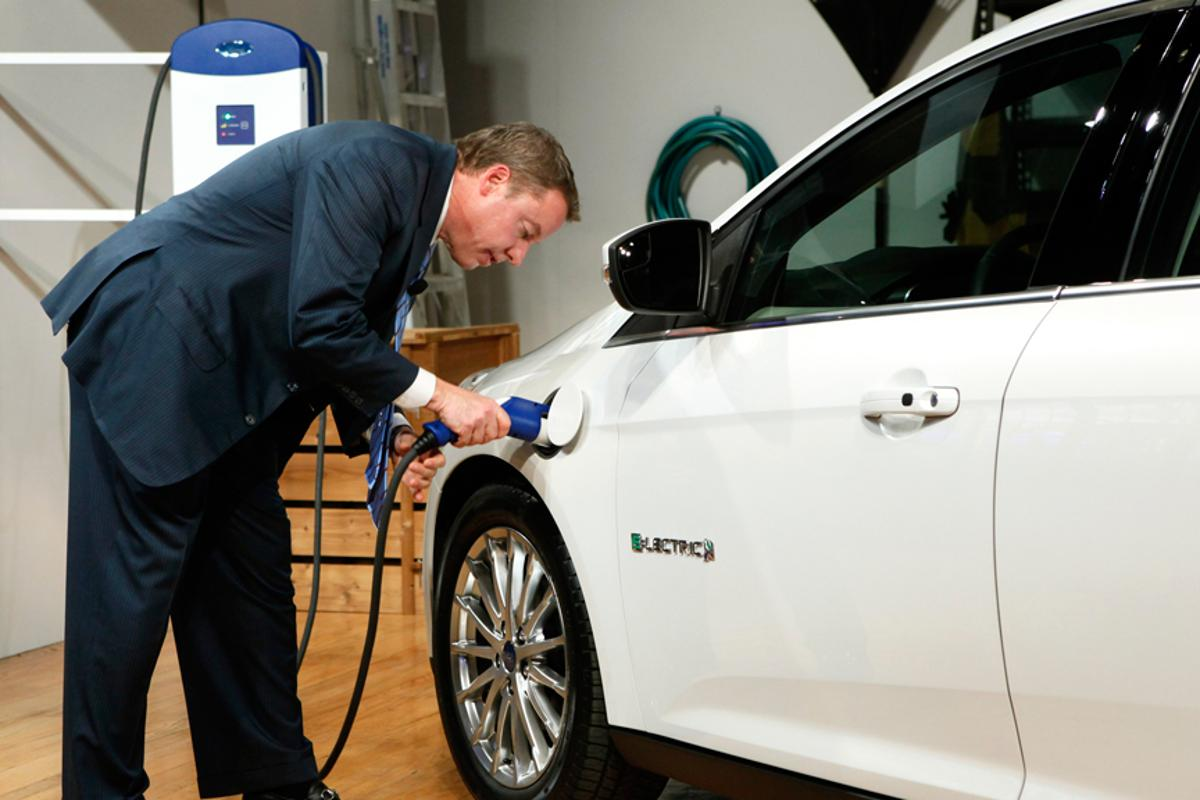 Ford Motor Company, Executive Chairman Bill Ford charges the Ford Focus Electric using the home charging station
