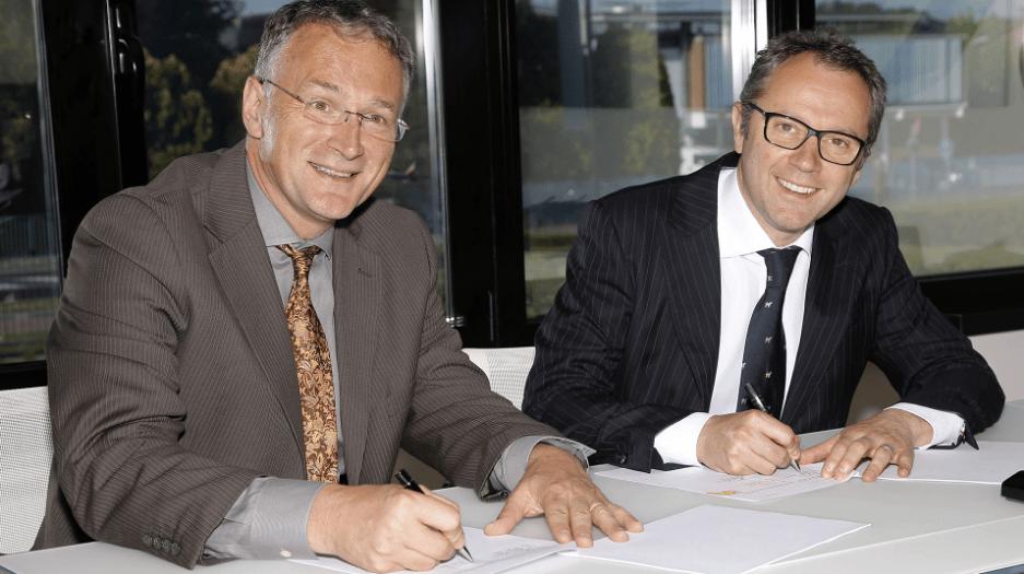 Stefano Domenicali, CEO Automobili Lamborghini (left)and Mauro Ferrari, PhD, CEOof Houston Methodist Research Institute, sign agreements in Italy