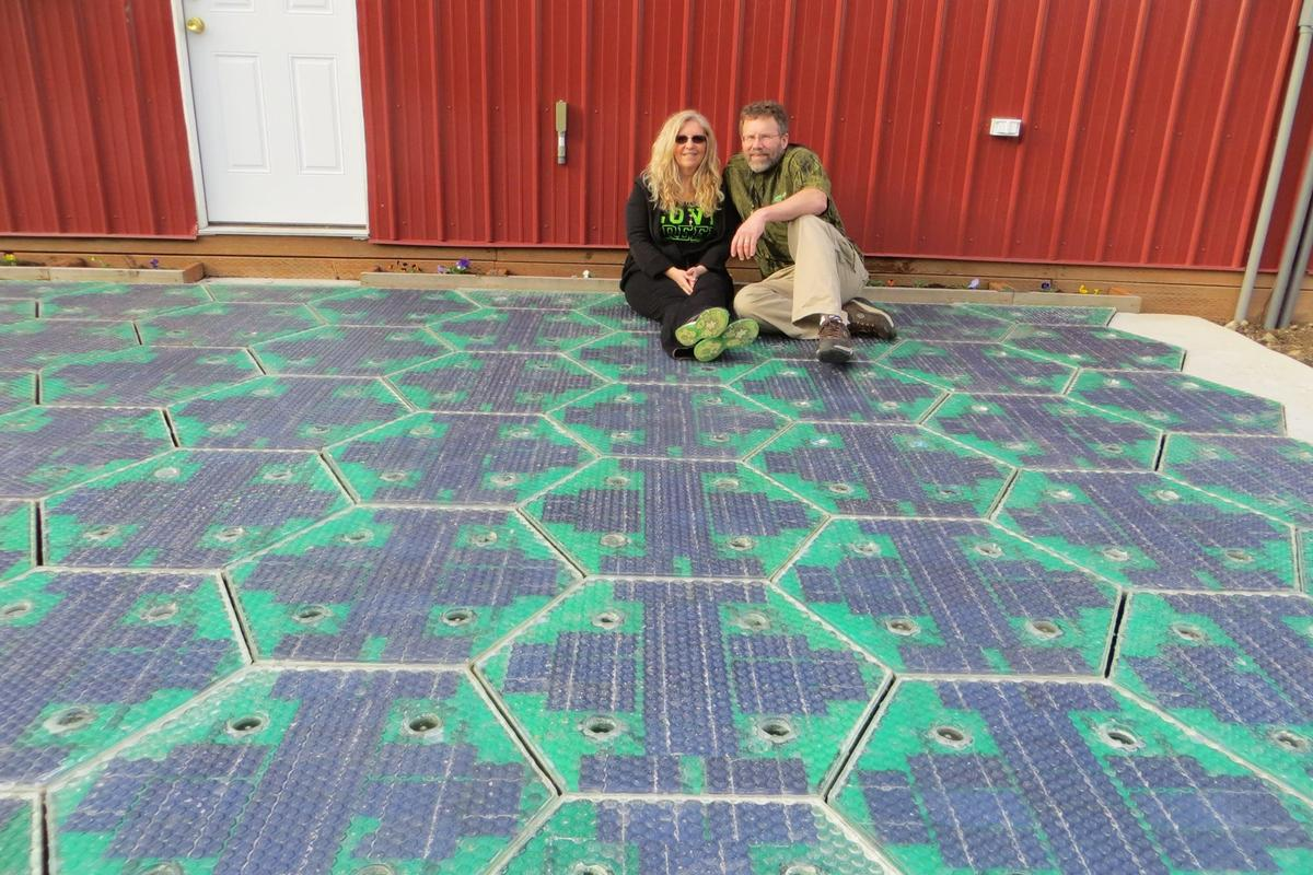Scott and Julie Brusaw relax on the new parking lot