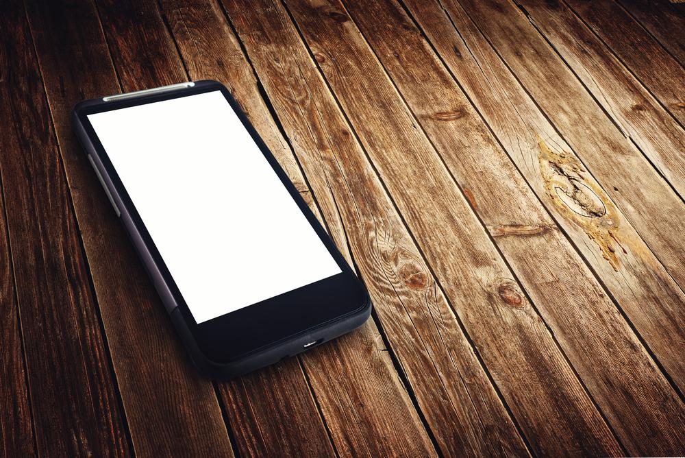 Using the AutoCharge system, users would just put their phone down anywhere on a regular table to be recharged (Photo: Shutterstock)