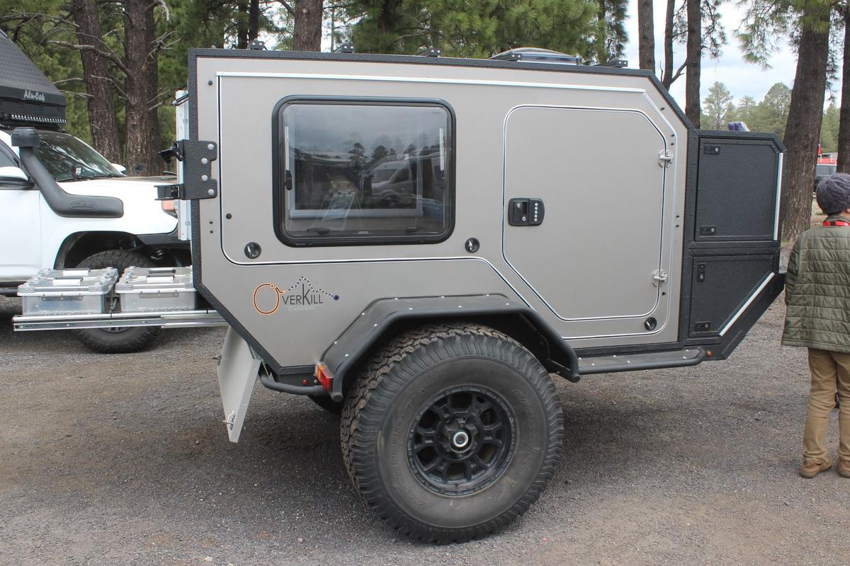 The Overkill T.K.4.7 is a compact, little squaredrop trailer that opens up to create ascenic campsite