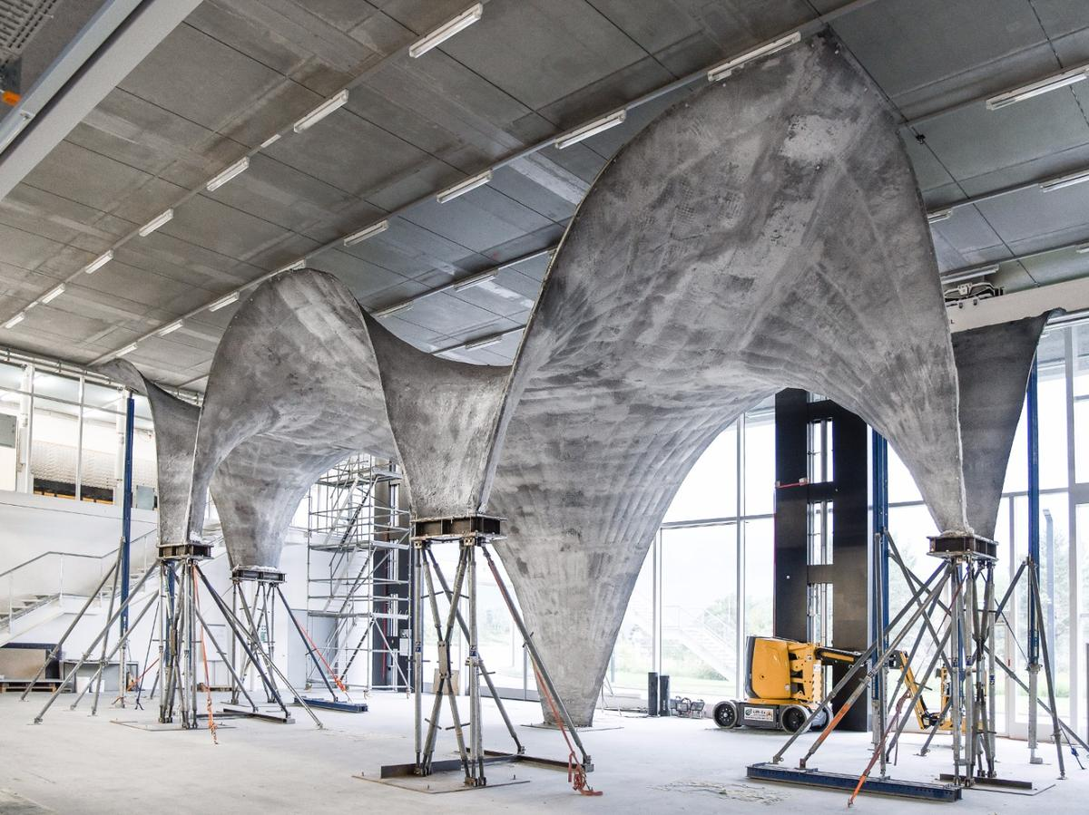 Ultra Thin Curvy Concrete Roof Is A Monument To Digital Design