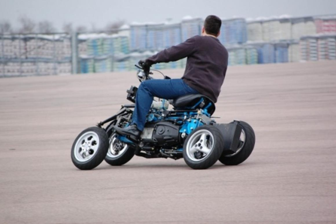 Thanks to its four-wheeled design and ingenious suspension system, which means it can go to full lean, complete with a rider, without falling over even at a standstill