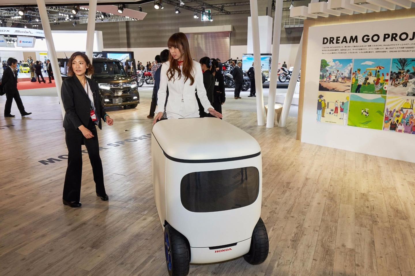 An odd twist on urban transport, Honda's RoboCas is a robot, auto-follow cargo trailer, urban transporter and vending stand all in one