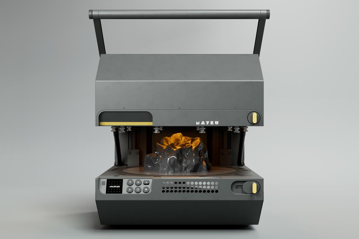 The Mayku Multiplier with its forming platform open, revealing a freshly made template mold within