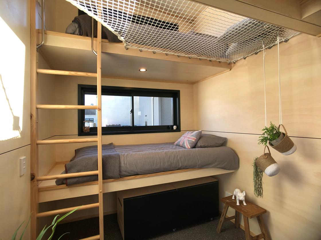 The Tiny Tāwharau features a bunk bed sleeping area for the kids