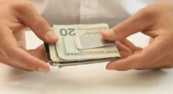 The KeyLet loaded with a stack of money and credit cards