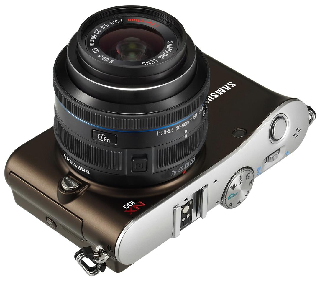 The Samsung NX100 mirrorless camera boasts the world's first i-Function Lens
