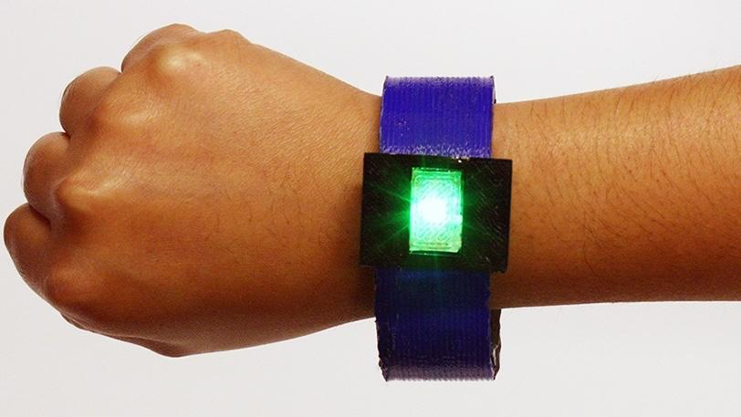 The 3D-printed battery in this bracelet kept the LED lit for approximately one minute