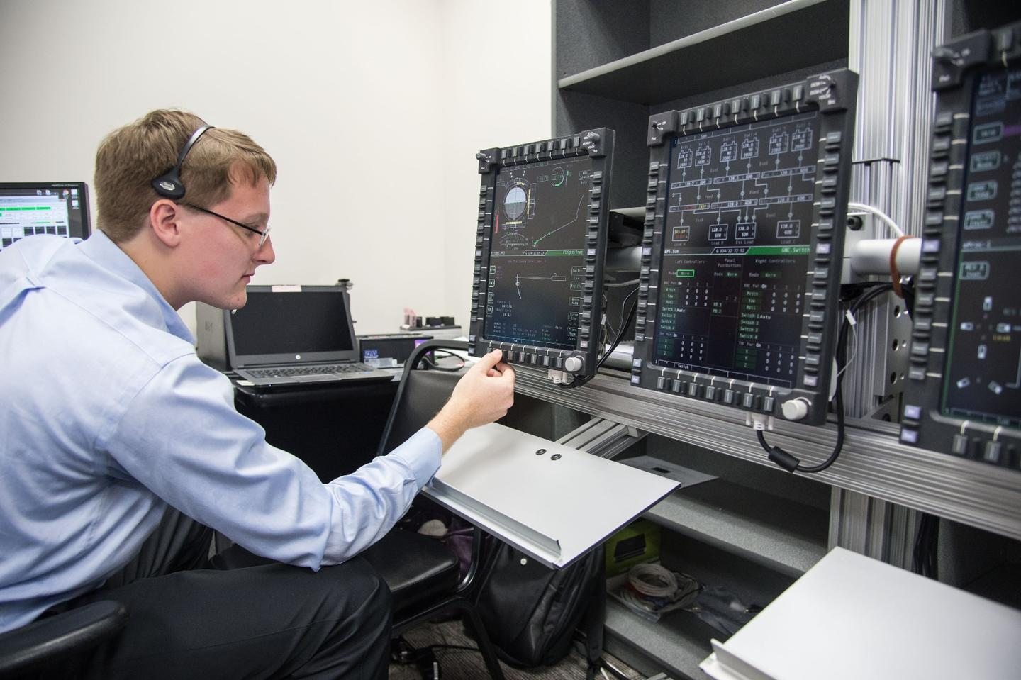 An engineer evaluates Orion's display and control system