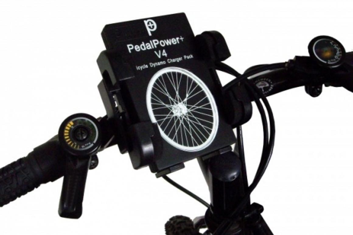 The heart of the PedalPower+ system, the V4 charging unit mounted on the handlebars