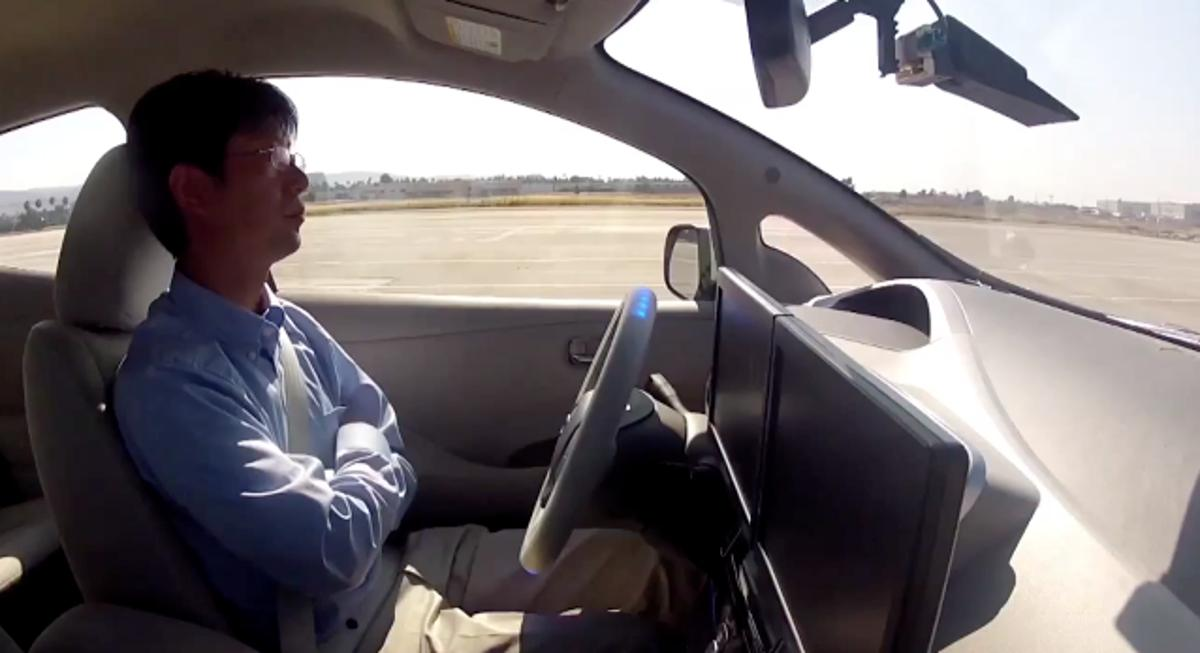 A test driver going hands-free in the Autonomous Drive LEAF