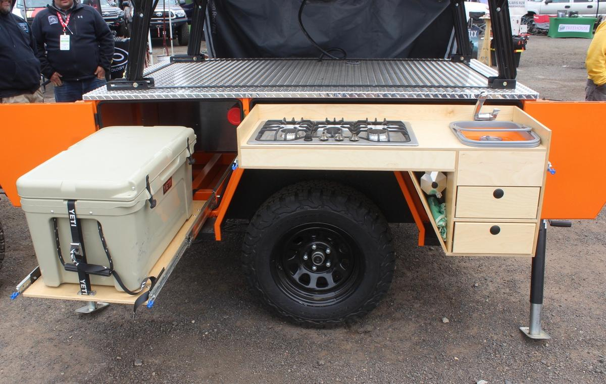 Colorado Backcountry dedicates one side of the Timberline trailer to the slide-out kitchen