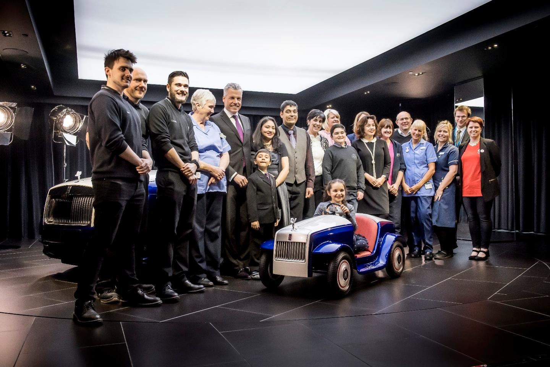 The team responsible for the Rolls-Royce SRH, alongside representatives fromthe Pediatric Unit at St Richard's Hospital and theMatthews andRajyaguru families