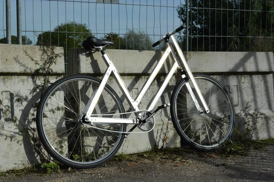 The Reframed bike's frame is made from extruded aluminum, and is bolted together by the buyer