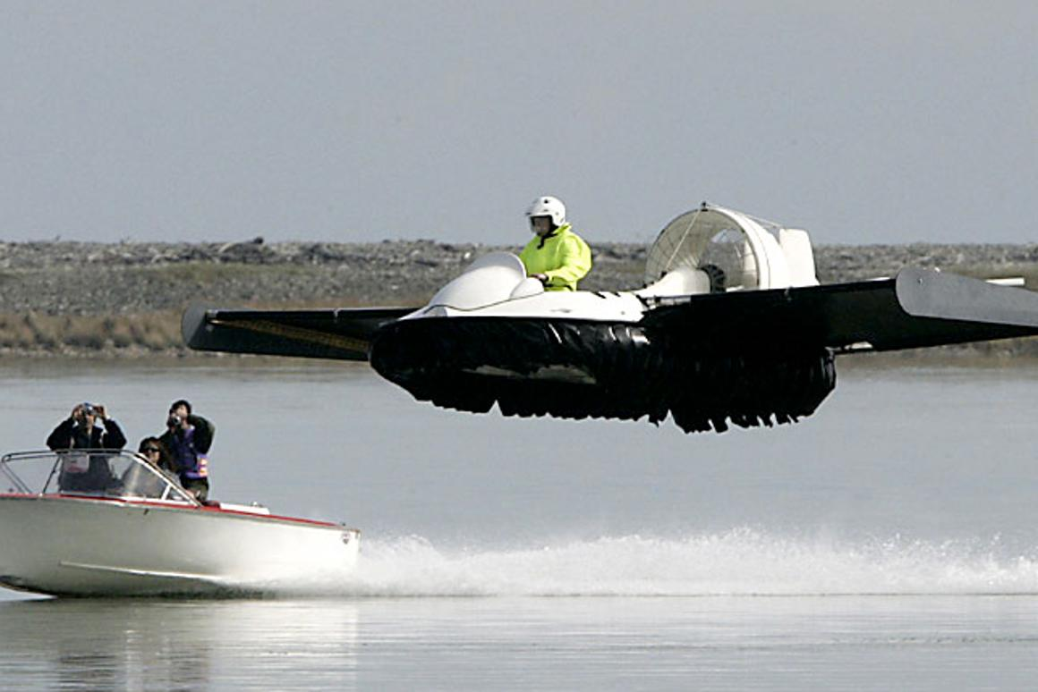 """The """"Hoverwing"""" home-made hovercraft-type vehicle on a test flight with a rescue vehicle in close proximity in New Zealand's south island (Photo: Marion van Dijk/Nelson)"""