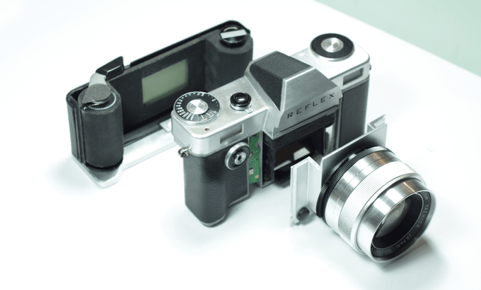 The Reflex camera features a removable film back and interchangeable lens mounts