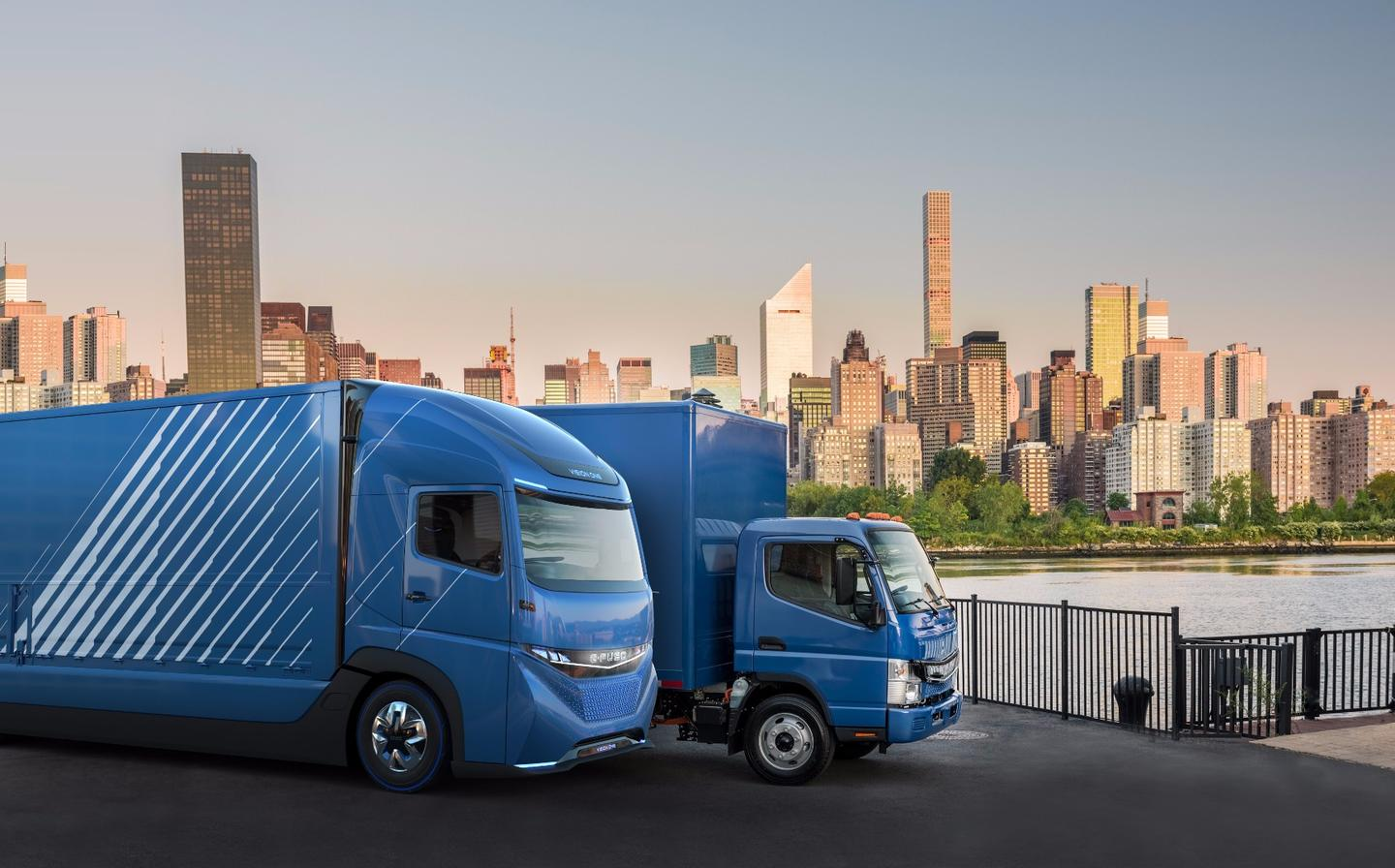 The E-Fuso Vision Onesits alongside the eCanter truck, which launched in 2017