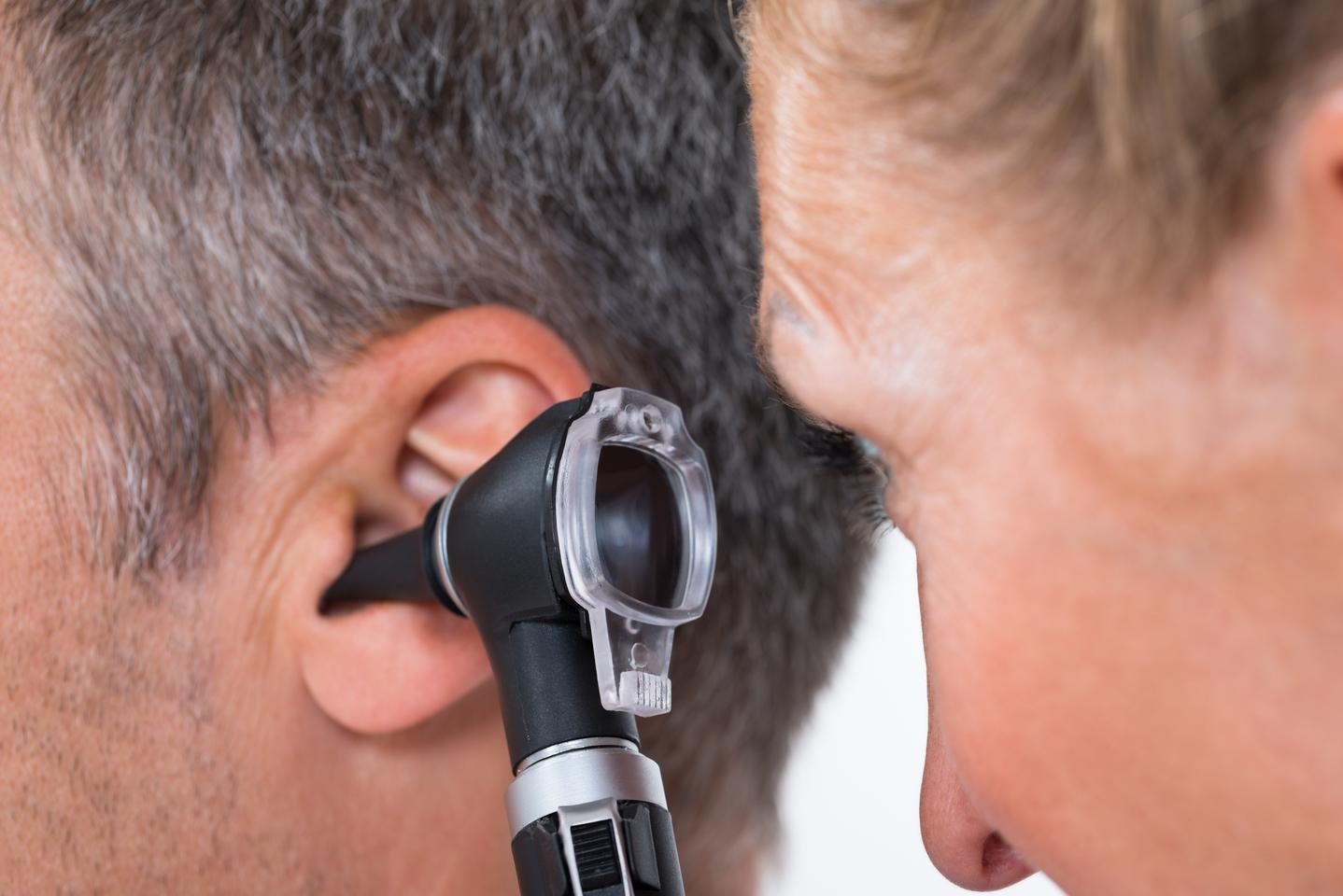A conventional otoscope, being used to examine a patient's ear
