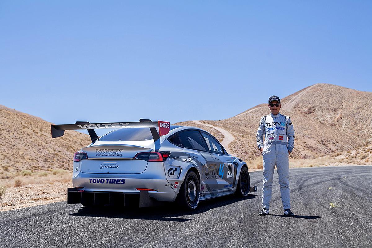 Daijiro Yoshihara alongside the modified Tesla Model 3 Performance