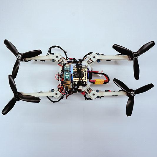 The foldable drone in its H-shaped configuration, which allows it to squeeze through narrow vertical openings