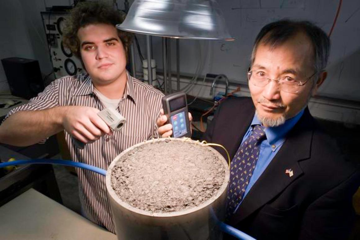 University of Rhode Island graduate student Andrew Correia (left) and Prof. K. Wayne Lee, measuring the solar energy generated by a patch of asphalt