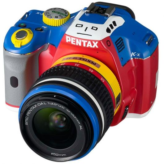 The lens and the camera body are styled just like the Korejanai Robo toy, with the pop-up flash being the robot's head