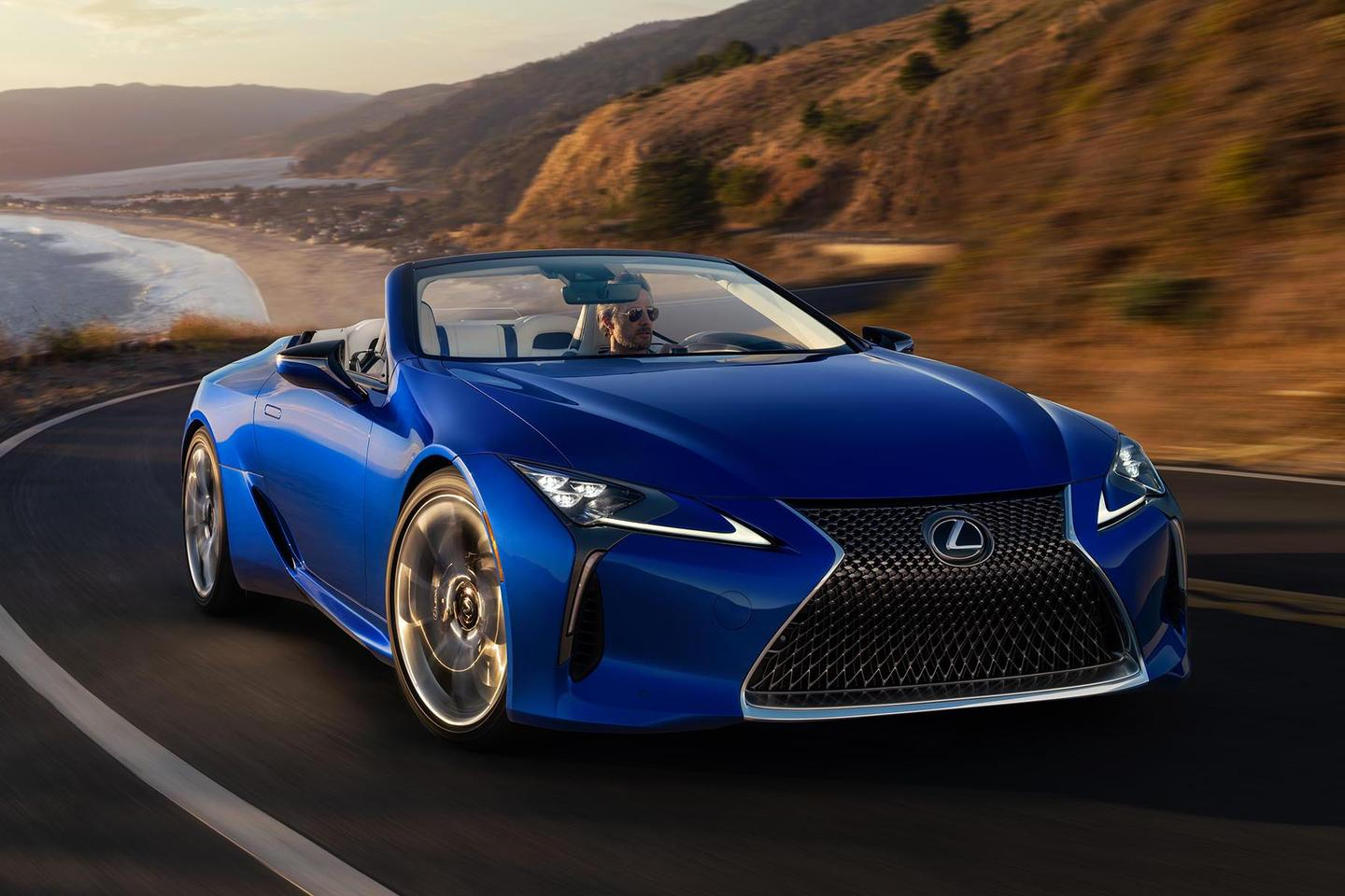 """This is the first 2021 Lexus LC 500 Convertible. The car is one of 100 cars customized to be part of the 2021 Lexus LC 500 Convertible Inspiration Series, with special paint, wheels and other component highlights, though the performance will be the same as other 471-hp LC 500s with a Direct-Shift 10-speed automatic transmission. The big difference is that this car bears VIN 100001, and carbon-fiber scuff plates imprinted with """"LC Inspiration Series Launch Exclusive 1 of 1.""""2"""