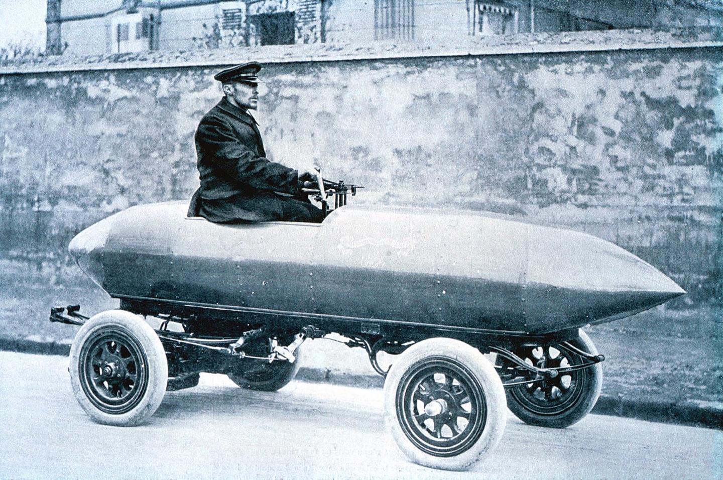 """Jenatzy created the first """"purpose built"""" car for a land speed record which he named the """"Jamais Contente."""" Thetorpedo-shaped electric vehicle made extensive use of """"partinium"""", a strong, lightweight and expensive alloy made of aluminum, copper, zinc, silicon and iron which had not been previously used in a car. The car ran65.79 mph (105.26 km/h) for the final chapter in the duel."""
