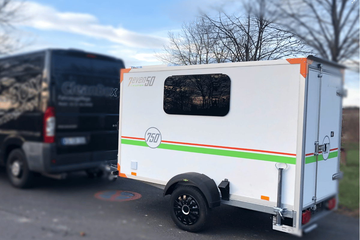What looks like a basic cargo trailer outside is actually a cozy mini-camper