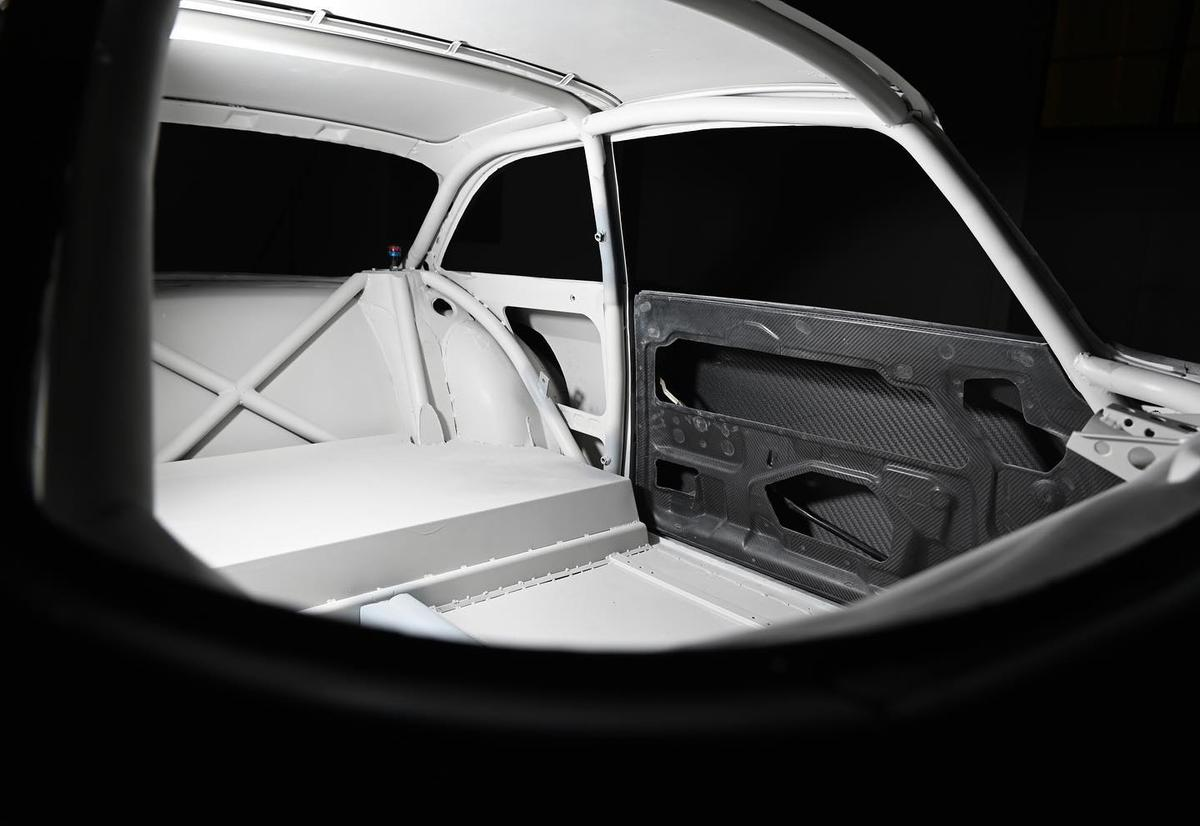The roll cage follows the original contours of the car to add strength without changing the classic look