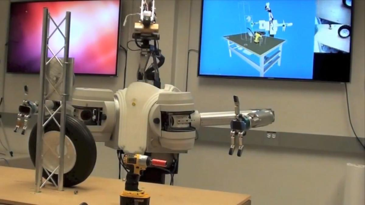 DARPA is developing an autonomous robotic arm that requires only simple commands to performs complex tasks, like changing a tire or defusing explosive devices